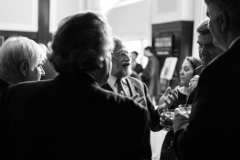 Guests enjoying animated conversation at the reception